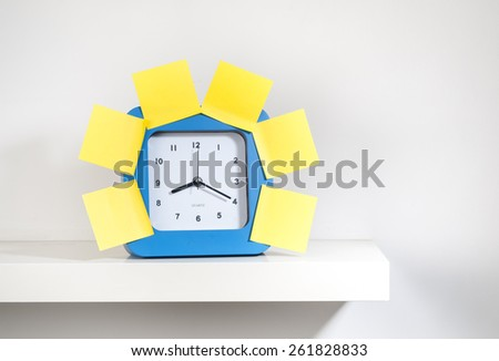 Many sticky notes stuck on the big clock - stock photo
