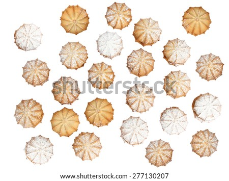 Many sweet cookie with flour over it on white background, from above. - stock photo