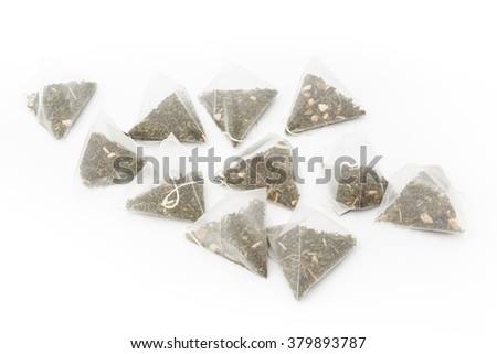 many tea bags on white background  - stock photo