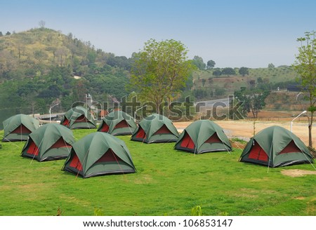 Many Tents on green grass, Ready for summer camping fun. - stock photo