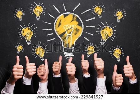 many thumbs up to ideas - stock photo
