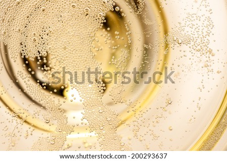 Many tiny bubbles in a champagne glass - stock photo