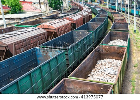 Many trains with cargo wagons on the railroad - stock photo