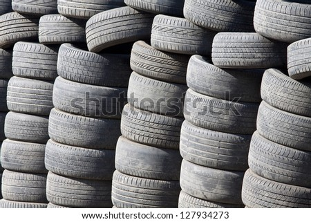 Many tyres and wheels under sunshine - stock photo