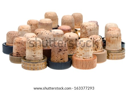 many used corks from strong drinks isolated on white background - stock photo