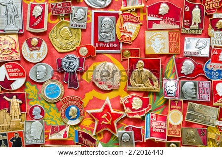 many vintage Soviet Union (former Russia) badges on red banner - stock photo