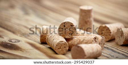 Many wine corks on wood barrel - stock photo