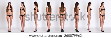 Many woman figures  fill length from all angles in black underwear in studio with grey background. Not object. - stock photo