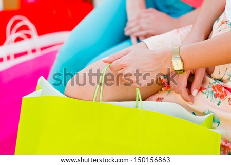 Many women with many colorful shopping bags. - stock photo