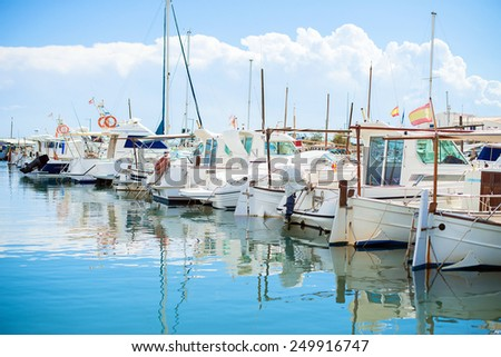 Many yachts and boats in the harbor. - stock photo