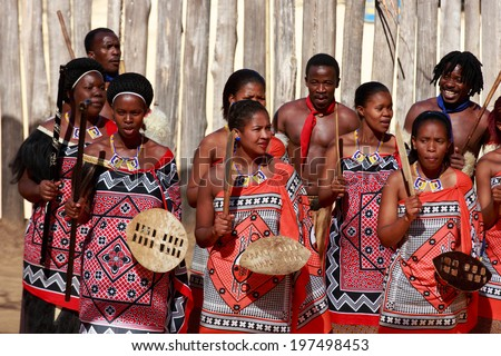 MANZINI, SWAZILAND - MAY 30 : unidentified group of young men and woman wears traditional clothing and dance, during presentation of a Swazi show on May 30, 2014 Manzini, Swaziland - stock photo