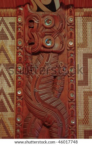 Maori wall carvings in a Marae (meeting house) - stock photo
