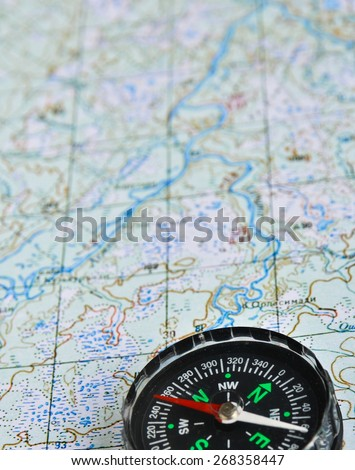 Map and compass. Photo magnetic compass located on a topographic map. - stock photo