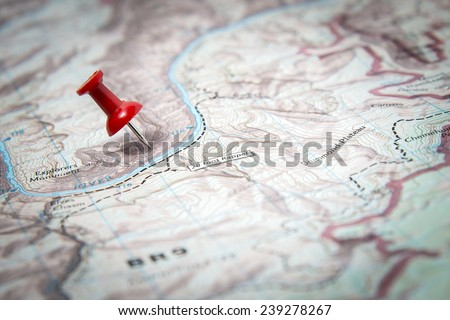 Map marked with red pushpin - stock photo