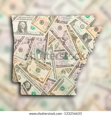 Map of Arkansas, filled with US dollars - stock photo