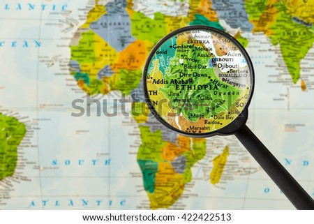 Map of Federal Democratic Republic of Ethiopia through magnigying glass - stock photo
