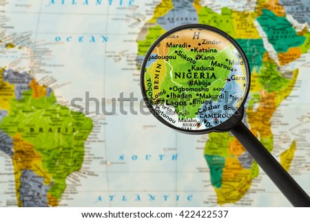 Map of Federal Republic of Nigeria through magnigying glass - stock photo