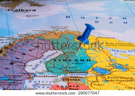 Map of Finland with a blue pushpin stuck - stock photo