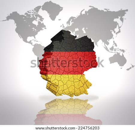 Map of Germany with German Flag on a world map background - stock photo