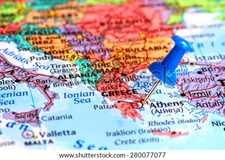 Map of Greece with a blue pushpin stuck - stock photo