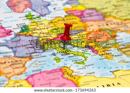 Map of Italy with a white pushpin stuck - stock photo