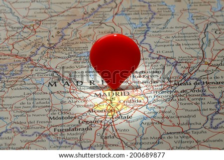 Map of Madrid/Red map pointer stuck into of Madrid - stock photo