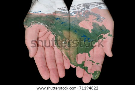 Map Of North America Painted On Hands Showing Concept Of North America In Our Hands - stock photo