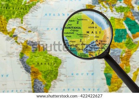 Map of Republic of Mali through magnigying glass - stock photo
