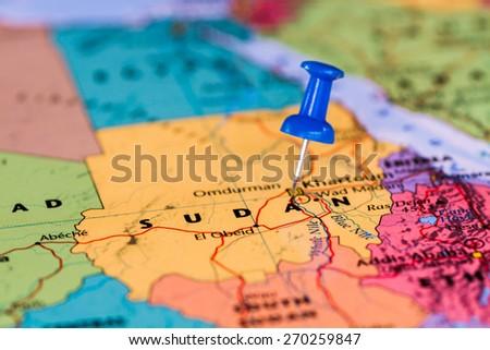 Map of Sudan  with a blue pushpin stuck - stock photo