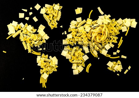 map of the world made of raw pasta on black background - stock photo