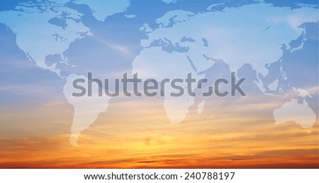 Map of the world super imposed over a vivid orange and blue sunrise. -original map from NASA - stock photo