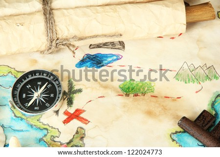 map of treasures on wooden background - stock photo