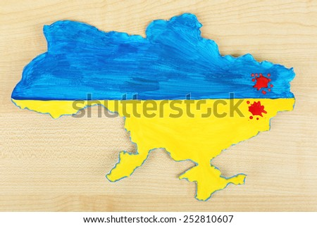 Map of Ukraine with blood - concept of war in the country - stock photo