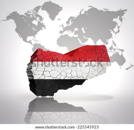 Map of Yemen with Yemen Flag on a world map background - stock photo