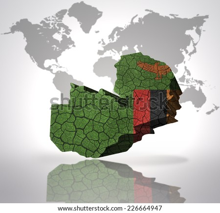 Map of zambia with zambian Flag on a world map background - stock photo
