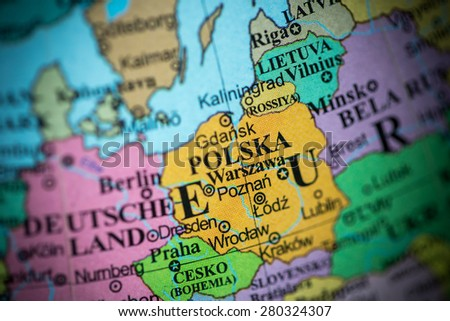 Map view of Poland on a geographical globe. (vignette) - stock photo
