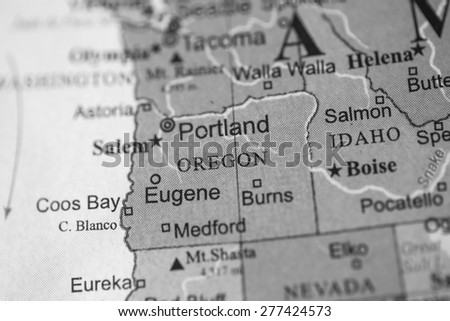 Map view of Portland on a geographical globe. (black and white) - stock photo