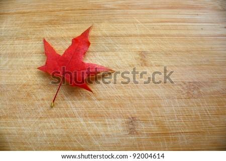 Maple Leaf on wood - stock photo