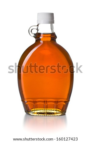 maple syrup in glass bottle on white background - stock photo