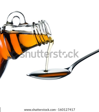maple syrup pouring on spoon on white background - stock photo