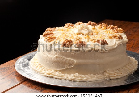 Maple Walnut Cinnamon Cake homemade on black background - stock photo