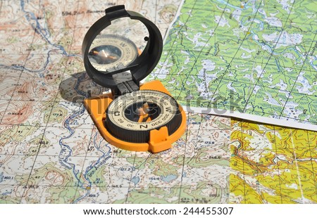 Maps and compass. Compass on the map - this is the open door to the country adventure. - stock photo