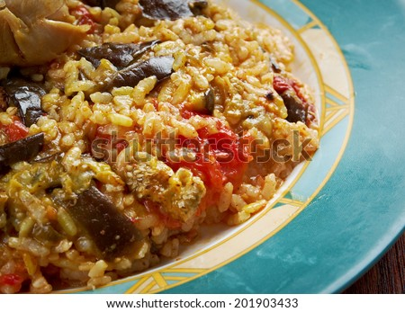 Maqluba  is a traditional dish of the Arab Levant, Persia, and Palestine.dish includes meat, rice, - stock photo