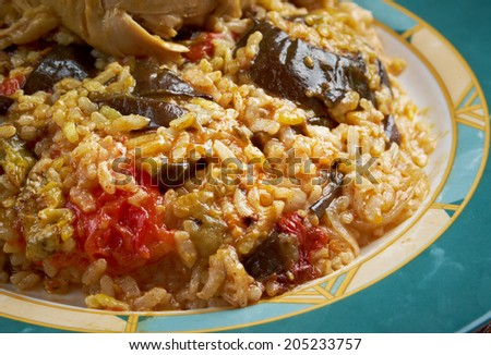 Maqluba  is a traditional dish of the Arab Levant, Persia, and Palestine.dish includes meat, rice, and fried vegetables placed in a pot,  - stock photo