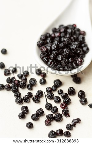 Maqui berries on a white spoon - stock photo