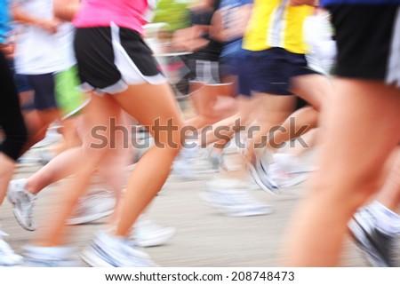 Marathon race motion blur - stock photo