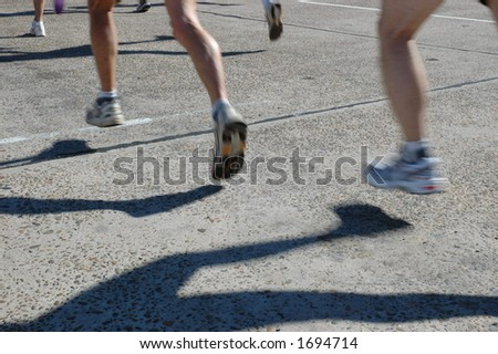 marathon runners in hot pursuit - stock photo