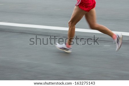 Marathon runners on the Road. Motion blurred - stock photo