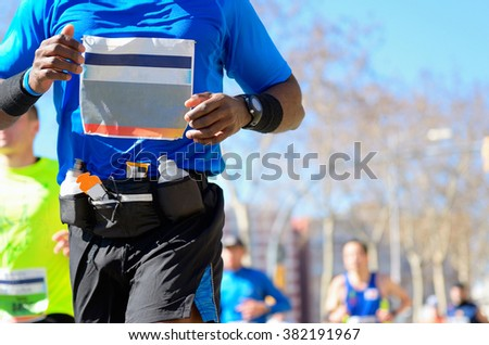 Marathon running race, black runner on road, sport, fitness and healthy lifestyle concept  - stock photo