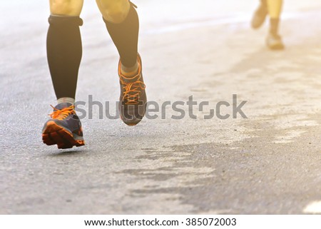 Marathon running race people competing in fitness and healthy active lifestyle feet on road : Vintage filter style - stock photo
